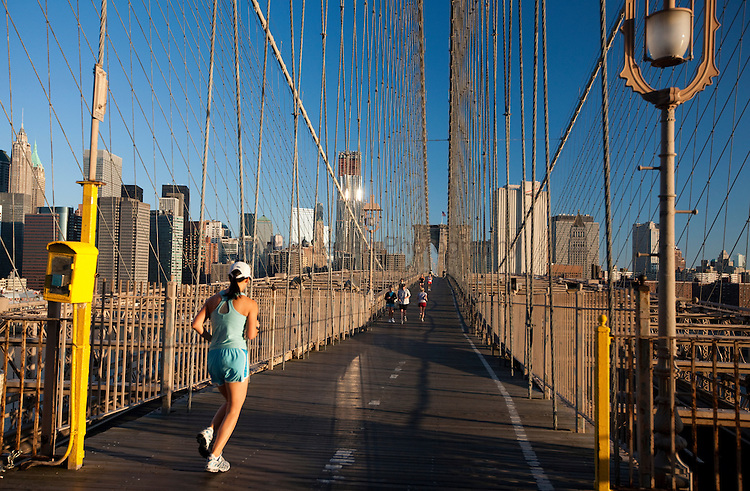 Runners crossing the Brooklyn Bridge in the morning