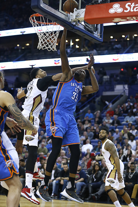 Oklahoma City Thunder forward Kevin Durant (35) goes to the basket against New Orleans Pelicans forward Anthony Davis (23) during the second half of an NBA basketball game Thursday, Feb. 25, 2016, in New Orleans. The Pelicans won 123-119. (AP Photo/Jonathan Bachman)