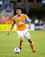 Houston Dynamo forward Brian Ching (25) dribbles the ball.  Houston Dynamo tied Seattle Sounders 1-1 on August 23, 2009 at Robertson Stadium in Houston, TX.