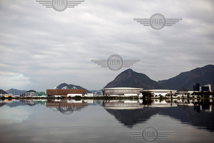 A view of Olympic Park from Lagoa da Jacarepagua, one of the many inter-connected lagoons that, as developement in the area grows, are increasingly pollututed by raw sewage and waste.<br />  <br /> <br /> The authorities and private developers have poured billions of dollars into transportation projects, hotels, a residential complex to house the athletes and a vast Olympic Park where nearly half the sports will be played in Rio's expansive neighbourhood, Barra da Tijuca. <br /> <br /> Those improvements join the private schools, gated communities, and other consumer culture that attracts middle-class families tired of run-down feel of Rio's older neighbourhoods. <br />  <br /> However, the breakneck development has brought problems similar to those of which its new residents were fleeing, including congested traffic and untreated sewage in what was supposed to be a new model for urban living.
