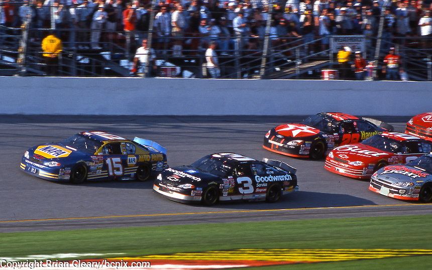 Dale Earnhardt (3) battles Michael Waltrip for the lead late in the Daytona 500 at Daytona International Speedway, Daytona Beach , FL, February 2001.  (Photo by Brian Cleary/www.bcpix.com)