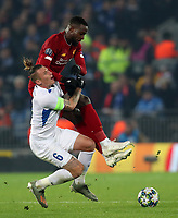 5th November 2019; Anfield, Liverpool, Merseyside, England; UEFA Champions League Football, Liverpool versus Genk; Sebastien Dewaest of KRC Genk is fouled by Divock Origi of Liverpool - Editorial Use