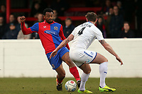 Chike Kandi of Dagenham  and Ritchie Sutton of Tranmere Rovers during Dagenham & Redbridge vs Tranmere Rovers, Vanarama National League Football at the Chigwell Construction Stadium on 10th March 2018