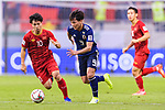 Minamino Takumi of Japan (C) fights for the ball with Nguyen Cong Phuong of Vietnam (L) during the AFC Asian Cup UAE 2019 Quarter Finals match between Vietnam (VIE) and Japan (JPN) at Al Maktoum Stadium on 24 January 2018 in Dubai, United Arab Emirates. Photo by Marcio Rodrigo Machado / Power Sport Images