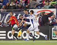 New England Revolution forward Marko Perovic (29) attempts to control the ball as Kansas City Wizards defender Roger Espinoza (17) pressures. The New England Revolution defeated Kansas City Wizards, 1-0, at Gillette Stadium on October 16, 2010.