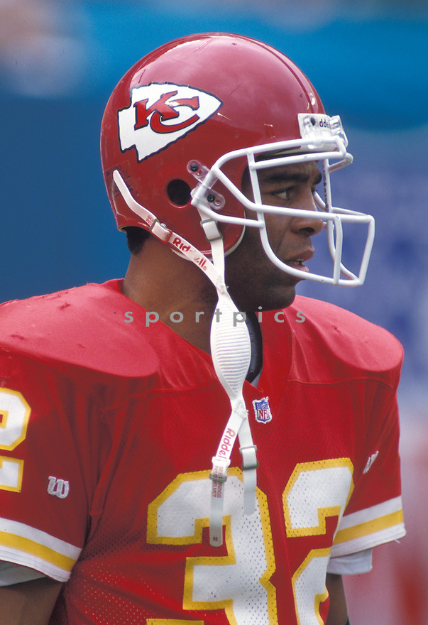 Kansas City Chiefs Marcus Allen (32) during a game against the Miami Dolphins at Joe Robbie Stadium in Miami, Florida on October 31, 1993.  The Dolphins beat the Chiefs 30-10.   Marcus Allen played for 16 years with 2 different teams, was a 6-time Pro Bowler and was inducted to the Pro Football Hall of Fame in 2003.