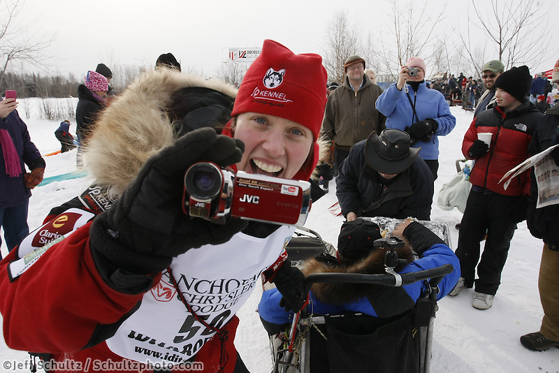 Saturday March 6 , 2010  Aliy Zirkle stops her team at her sponsor , Horizon Lines , annual Iditarod hot dog pit stop along the trail near Tudor Road during the ceremonial start of the 2010 Iditarod in Anchorage , Alaska