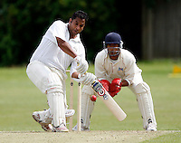 Hornsey / Highgate.Middlesex County League Division 3.Tivoli Road, Hornsey, July 14, 2007.Pic : Max Flego (Tel : 07977-130141 / 01322-339410).Chetan Patel hits out for Hornsey