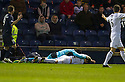 Dundee keeper Kyle Letheren and Raith Rovers' Reece Donaldson lie injured after colliding in mid air.