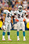 9 October 2005: Channing Crowder (52), linebacker for the Miami Dolphins, and safety Tebucky Jones (24) look at a replay during a time out against the Buffalo Bills at Ralph Wilson Stadium, in Orchard Park, NY. The Bills defeated the division rival Dolphins 20-14. ..Mandatory Photo Credit: Ed Wolfstein