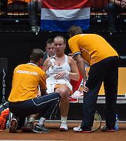 The Netherlands, Den Bosch, 20.04.2014. Fed Cup Netherlands-Japan, Kiki Bertens (NED) receiving medical treatment<br /> Photo:Tennisimages/Henk Koster
