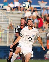 Danny Allsopp #9 of D.C. United pushes into Dustin Bixler #3 of the Harrisburg City Islanders during a US Open Cup match at the Maryland Soccerplex on July 21 2010, in Boyds, Maryland. United won 2-0.