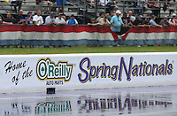 Apr. 27, 2013; Baytown, TX, USA: Detailed view of water on the track during a rain delay to qualifying for the Spring Nationals at Royal Purple Raceway. Mandatory Credit: Mark J. Rebilas-
