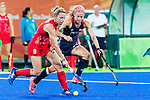 Susannah Townsend #9 of Great Britain is closely marked by Kathleen Sharkey #24 of United States during Great Britain vs USA in a women's Pool B game at the Rio 2016 Olympics at the Olympic Hockey Centre in Rio de Janeiro, Brazil.