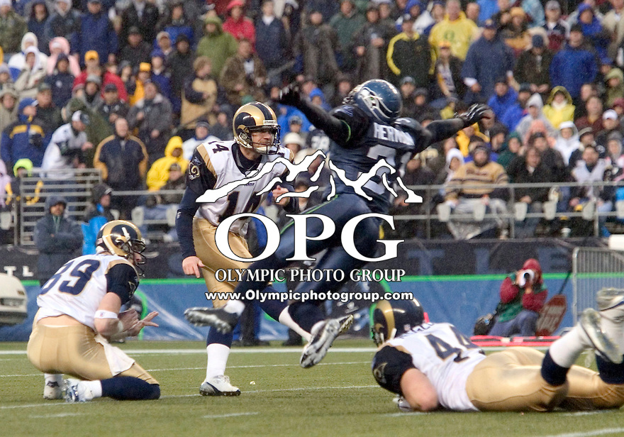 13 Nov 2005:   St. Louis Rams kicker Jeff Wilkens attempts a 31 yard field goal during the third quarter as Seattle Seahawks Kelly Herndon stretches out to block the kick. The field goal was good at Qwest Field in Seattle, Washington.