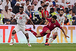 Akram Hassan Afif of Qatar (C) fights for the ball with Saif Rashid Alshemeili of United Arab Emirates (L) and Bandar Mohamed Al Ahbabi of United Arab Emirates (R) during the AFC Asian Cup UAE 2019 Semi Finals match between Qatar (QAT) and United Arab Emirates (UAE) at Mohammed Bin Zaied Stadium  on 29 January 2019 in Abu Dhabi, United Arab Emirates. Photo by Marcio Rodrigo Machado / Power Sport Images