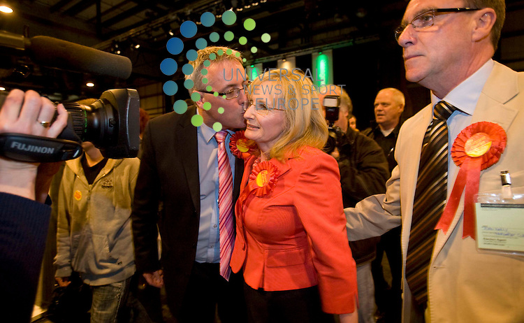Margaret Curran (Labour) standing in Glasgow East being kissed by Frank McAveety MSP Labour MSP for Glasgow Shettleston during the general election count at the Scottish Exhibition Centre (SECC), Glasgow..6 May 2010 Picture: Maurice McDonald/Universal News And Sport (Europe)...