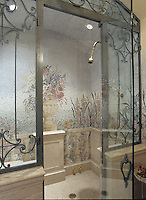 Custom floral shower mosaic in honed and polished marble.