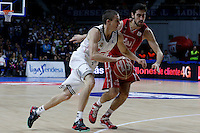 42 ISAAC FOTU Guards of CAI Zaragoza . 20 Jaycee Carroll Shooting guard of Real Madrid Baloncesto.2014 November 30 Madrid Spain. ACB LIGA ENDESA 14/15, 9º Match, match played between Real Madrid Baloncesto vs CAI Zaragoza at Palacio de los deportes stadium.