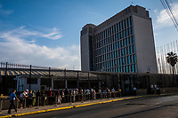 HAVANA, CUBA - SEPTEMBER 09: Cubans queue to enter the United States Embassy to apply for visas, on 9th of September, 2015 in Havana, Cuba. <br /> <br /> Daniel Berehulak for The New York Times