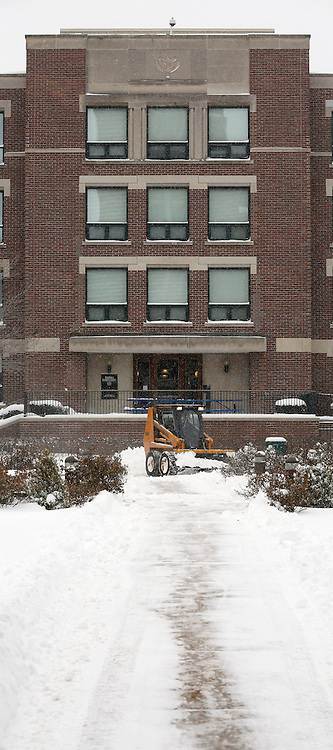 Crews plow through snow on the quad of the DePaul University's Lincoln Park campus in Chicago as the New Year brought two days of lake effect snow and ice. (Photo by Jamie Moncrief)