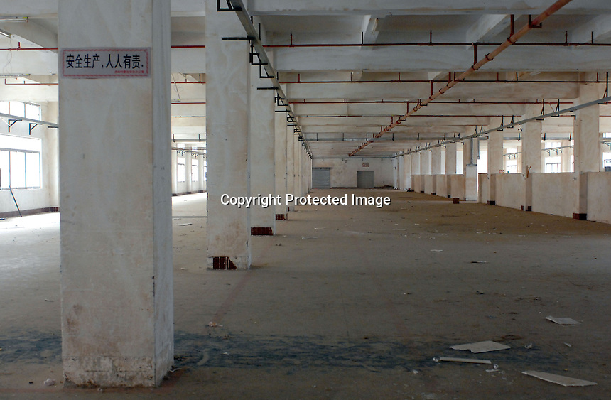 A deserted factory in Houjie Town, Donguan, China.  As the economy changes and Chinese labour gets more expensive, factories are cosing leaving ghost towns behind them.<br /> <br /> MUST CREDIT PHOTO BY RICHARD JONES/SINOPIX