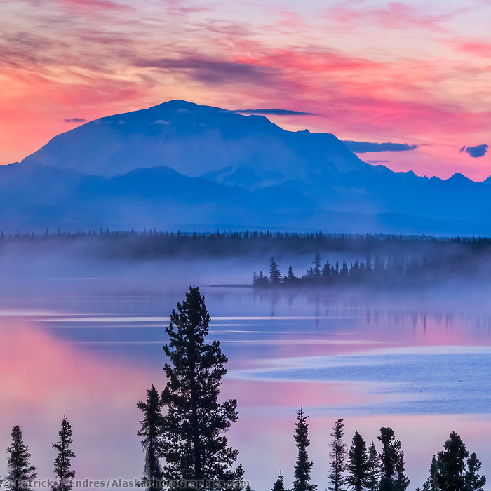 Colorful sky at dawn over willow lake and mount Blackburn,16390 ft., Wrangell St. Elias National Park, Alaska.