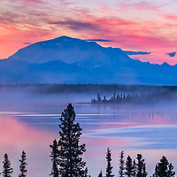 Panorama of colorful sky at dawn over Willow Lake and Mount Blackburn,16390 ft., Wrangell St. Elias National Park, Alaska.