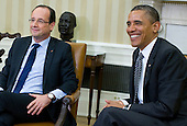 United States President Barack Obama meets with newly elected President Francois Hollande of France in the Oval Office of the White House in Washington, D.C. on Friday, May 18, 2012. The meeting comes at the start of a weekend that will include the G8 Summit held at Camp David in Maryland and the NATO Summit in Chicago, Illinois. .Credit: Kristoffer Tripplaar  / Pool via CNP