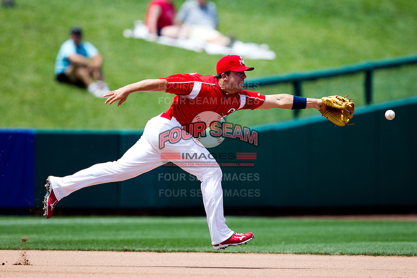 Zack Cox (7) of the Springfield Cardinals attempts to make a play on hard hit ball to third base during a game against the San Antonio Missions on May 30, 2011 at Hammons Field in Springfield, Missouri.  Photo By David Welker/Four Seam Images