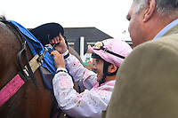 Jockey Marco Ghiani unsaddles Bounty Pursuit in the Winner's enclosure after winning The Shadwell Racing Excellence Apprentice Handicap Div 2  during Horse Racing at Salisbury Racecourse on 14th August 2019