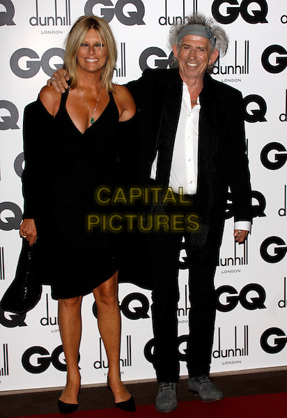 PATTI HANSEN & KEITH RICHARDS.GQ Men Of The Year Awards 2011 arrivals, Royal Opera House, London, England..September 6th, 2011.full length black suit dress grey gray headband married husband wife arm over shoulder scarf .CAP/COA/CC.©CC/COA/Capital .