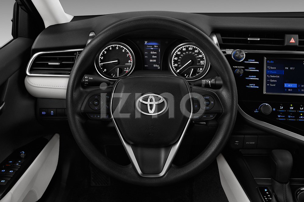 Car pictures of steering wheel view of a 2018 Toyota Camry LE Auto 4 Door Sedan