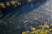 Aerial view from a helicopter of an Austin Rowing team early morning training in sculls on Lady Bird Lake in downtown Austin, Texas.