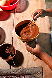 BELIZE, Punta Gorda, Village of San Pedro Colombia, mixing ground Cacao beans into a chocolate drink