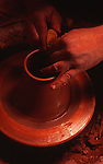 Potter works on potters wheel<br />