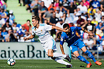 Marcos Llorente of Real Madrid (L) fights for the ball with Mauro Wilney Arambarri Rosa of Getafe CF (R)  during the La Liga 2017-18 match between Getafe CF and Real Madrid at Coliseum Alfonso Perez on 14 October 2017 in Getafe, Spain. Photo by Diego Gonzalez / Power Sport Images