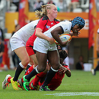 Maggie Alphonsi tackled by Mandy Marchak. WRWC England v Canada, World Cup Final at Stade Jean Bouin, Avenue du Général Sarrail, Paris, France, on 17th August 2014