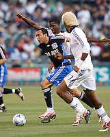 14 June 2008: Ramiro Corrales of the Earthquakes dribbles the ball away from Galaxy defenders during the game at McAfee Coliseum in Oakland, California.   Los Angeles Galaxy defeated San Jose Earthquakes, 3-0.