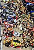 A busy pit road during the Aaron's 499 at Talladega Superspeedway, Talladega, AL, April 17, 2011.  (Photo by Brian Cleary/www.bcpix.com)