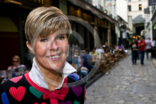 PARIS - FRANCE - 08 MAY 2011 -- Paris travel city photos. -- Helena PETAISTO (Petäistö) correspondent of the Finnish TV MTV3 on one of her favorite alleys, Passage du Commerce Saint Andre. -- PHOTO: Juha ROININEN / EUP-IMAGES