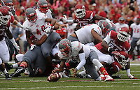 NWA Media/ANDY SHUPE - Nicholls quarterback Kalen Henderson reaches to recover a fumble during the first quarter Saturday, Sept. 6, 2014, at Razorback Stadium in Fayetteville