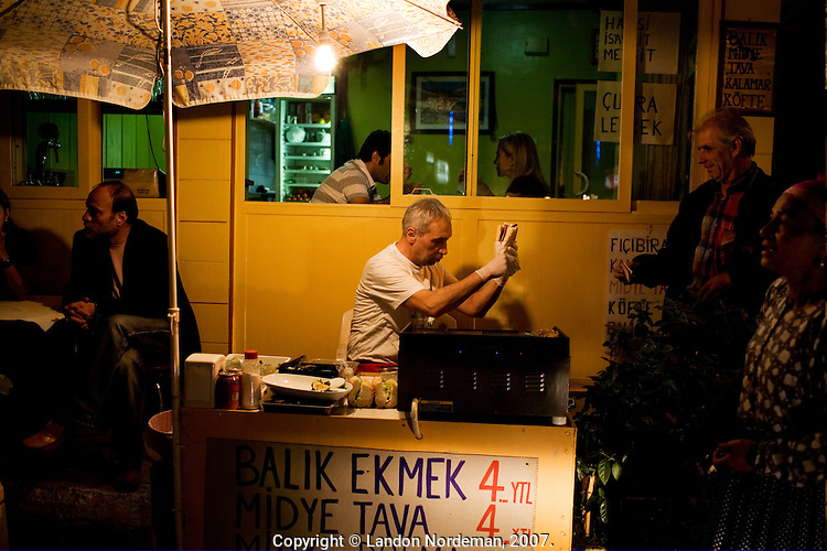 ISTANBUL - MAY 25, 2007:   A vendor sells snacks at night in Istanbul, Turkey. Photo by Landon Nordeman.
