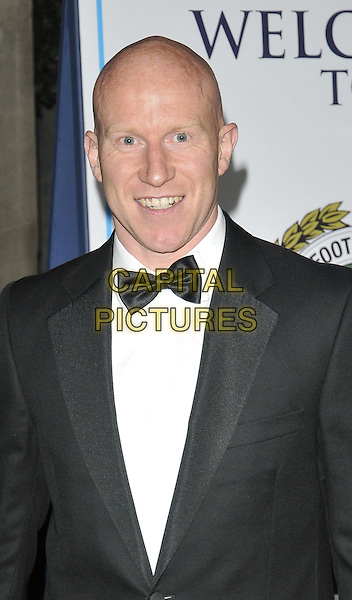 LEE HUGHES .At the Professional Footballers' Association Awards, Grosvenor House hotel, Park Lane, London, England, UK, 25th April 2010..PFA portrait headshot black bow tie tuxedo tux smiling .CAP/CAN.©Can Nguyen/Capital Pictures.