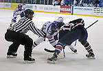 February 20, 2016 - Colorado Springs, Colorado, U.S. -   Air Force forward, Ben Carey #26, and Robert Morris forward, Spencer Dorowicz #15, in a face off during an NCAA ice hockey game between the Robert Morris University Colonials and the Air Force Academy Falcons at Cadet Ice Arena, United States Air Force Academy, Colorado Springs, Colorado.  Air Force defeats Robert Morris 4-1