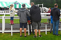 Young Racegoers watch horses in the Parade Ring  during Horse Racing at Salisbury Racecourse on 14th August 2019