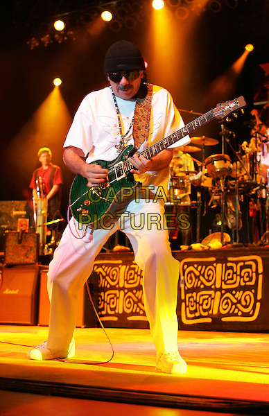 CARLOS SANTANA.Live at The Greek Theatre in Los Angeles, California  October 1, 2004.stage, concert, gig, guitar, full length, sunglasses, shades, hat.www.capitalpictures.com.sales@capitalpictures.com.Copyright Debbie VanStory