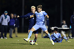 CARY, NC - NOVEMBER 19: North Carolina's Cam Lindley (6) and UNCW's Joel Bylander (SWE) (4). The University of North Carolina Tar Heels hosted the UNCW Seahawks on November 19, 2017 at Koka Booth Stadium in Cary, NC in an NCAA Division I Men's Soccer Tournament Second Round game. UNC won the game 2-1.