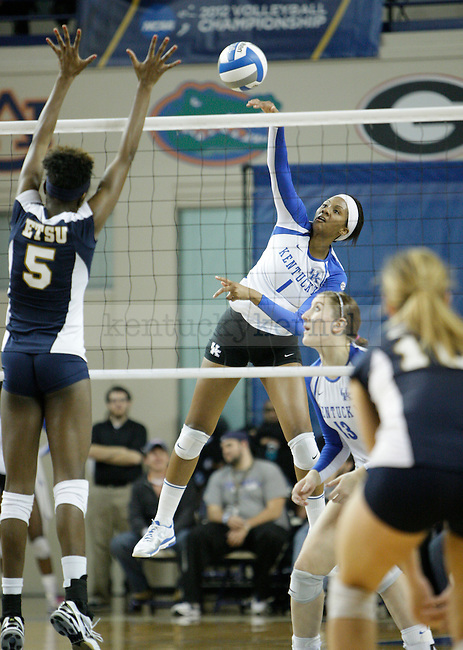 Junior Whitney Billings (1) spikes the ball during the UK women's volleyball game v. East Tennessee University during the NCAA tournament in Memorial Coliseum in Lexington, Ky., on Friday, November 30, 2012. Photo by Genevieve Adams | Staff