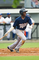 Nick Gordon (9) of the Elizabethton Twins follows through on his swing against the Burlington Royals at Burlington Athletic Park on June 25, 2014 in Burlington, North Carolina.  The Twins defeated the Royals 8-0. (Brian Westerholt/Four Seam Images)